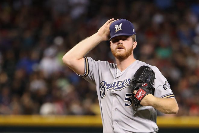 Even before he left the game with an oblique strain, Brewers starting pitcher Brandon Woodruff was having a rough go of it against the Diamondbacks as he allowed four runs on six hits with two walks and three strikeouts in just three-plus innings.