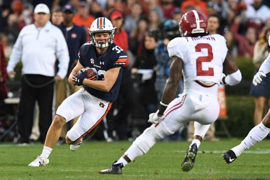 Auburn wide receiver Will Hastings (33) makes a catch against Alabama at Jordan-Hare Stadium on Nov. 25, 2017, in Auburn, Ala.