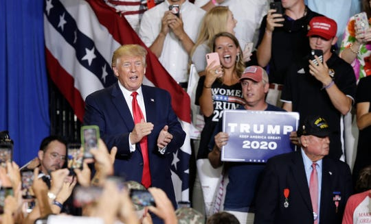 President Donald Trump greets supporters during a rally in Greenville, N.C., Wednesday, July 17, 2019. (AP Photo/Gerry Broome)