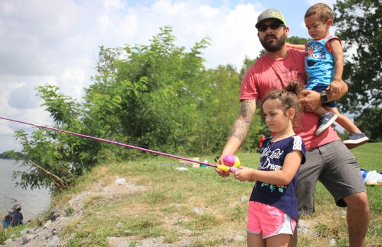 John Garza has his hands full at the Kids Fishing Derby in Gallatin on Saturday, July 29, 2019.