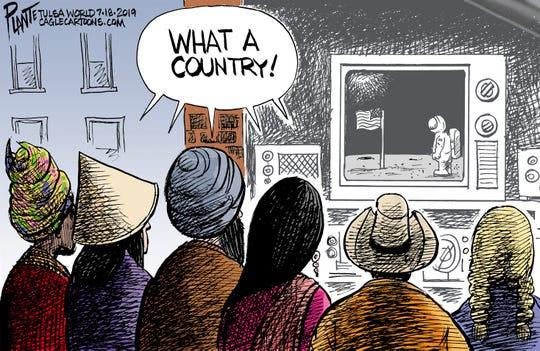 World watches moon landing.