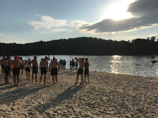 Athletes wait to swim at the Denville Triathlon.