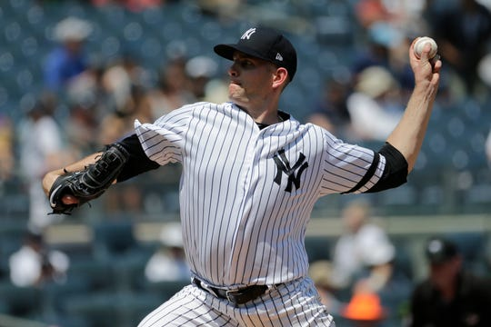New York Yankees starting pitcher James Paxton throws during the third inning of a baseball game against the Colorado Rockies at Yankee Stadium, Sunday, July 21, 2019, in New York. (AP Photo/Seth Wenig)