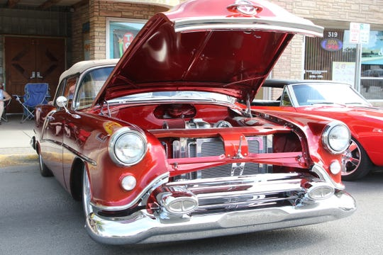 A 1954 Oldsmobile Starfire is on display during the Four Corners Rod Run car show Saturday in downtown Farmington.