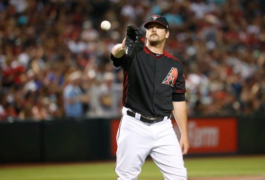 Diamondbacks' Andrew Chafin (40) reacts after giving up a three run home run against the Brewers at Chase Field in Phoenix, Ariz. on July 20, 2019.