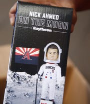To celebrate the 50th anniversary of the moon landing the Arizona Diamondbacks released an Astronaut Nick Ahmed Bobblehead for fans outside Chase Field in Phoenix, Ariz. on July 20, 2019.