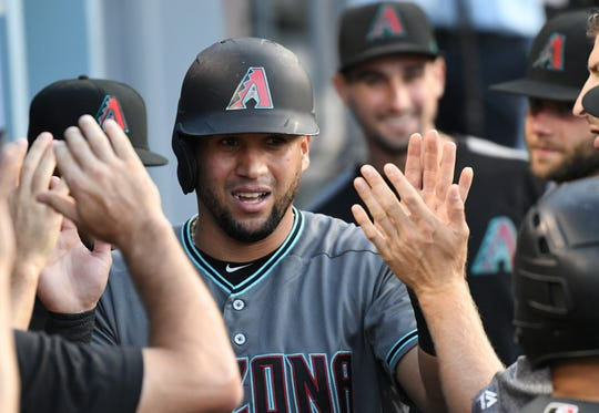 Jul 2, 2019: Arizona Diamondbacks left fielder David Peralta (6) celebrates in the dugout after scoring against the Los Angeles Dodgers in the first inning at Dodger Stadium.