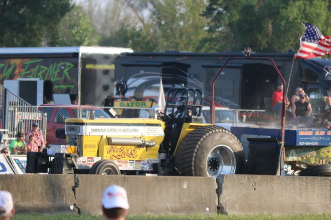"""John Cespedes, in his pro stock tractor """"Fool's Gold,"""" runs during the OSTPA Truck and Tractor Pull at the Ottawa County Fair on Saturday."""