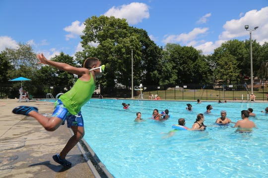 On the left Antoine James, 6, sets up to jump into Pulaski Park Pool in the City of Poughkeepsie on Sunday, July 21, 2019.
