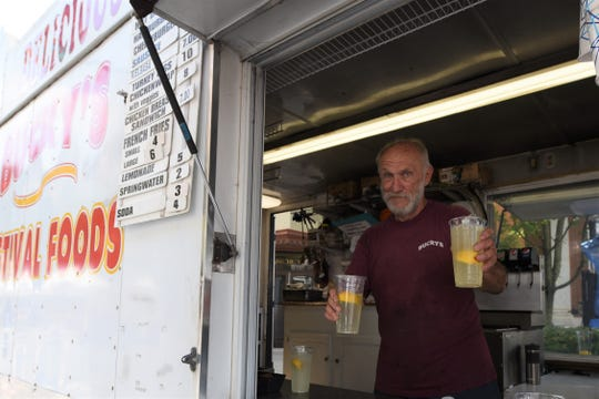 "Old Market Day was held in Downtown Chambersburg on Saturday, July 20, 2019. The ChambersFest Street festival features craft and food vendors, kids' activities and music. Benny Buck, of Harrisburg, has been serving up turkey legs (a fan favorite), fresh-squeezed lemonade and more from his food truck ""Bucky's Festival Foods"" for 31 years - 20 of those at ChambersFest."