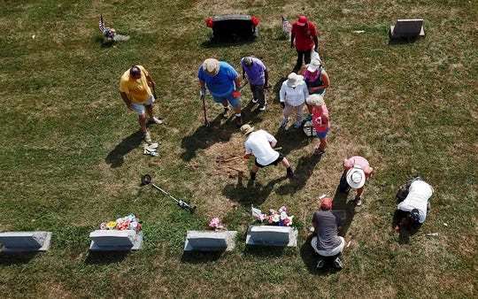Volunteers work to find and clear overgrown grave markers at Lebanon Cemetery in North York, Saturday, July 20, 2019. The cemetery, which was the first in York where African-Americans could be buried, has been in a state of neglect for many years. John A. Pavoncello photo