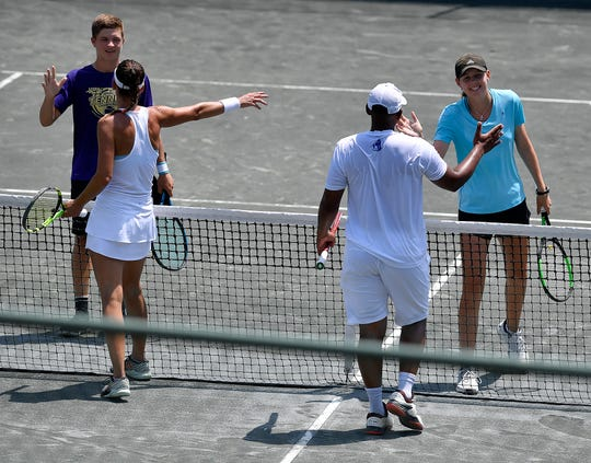 Holden Koons and Elizabeth Scotty are congratulated by defending champions Charlotte Sikora and Punch Maleka after Koons and Scotty won the Mixed Doubles Charity Classic tennis championship match, July 18, 2019.