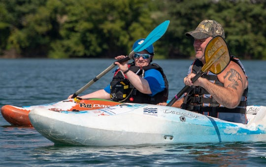 Jesse Miller, right, works with guide Jenn Eaton during the VisionCorps and Susquehanna Valley Team River Runner kayaking event at Codorus State Park. Miller, who is blind, was finding his way by following Eaton's verbal cues.