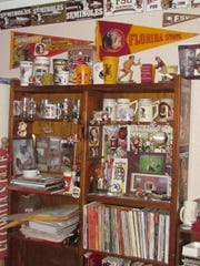 Chris Holder's FSU collection inspired him to launch the Garnet and Great Facebook page, where fans can buy and sell memorabilia.