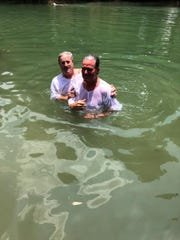 Doug Russell, right, at Yardenit, the baptismal site on the Jordan River.