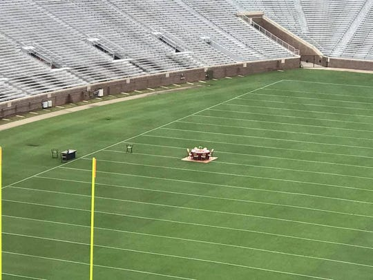 Dinner table set up on the 50-yard line at Doak Campbell Stadium.