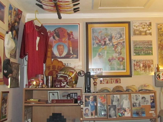 This wall of Chris Holder's FSU man cave has FSU posters dating back to 1979.
