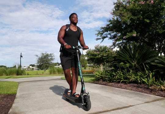 Joshua Butler, a FAMU student, 21, cruises through Cascades Park Saturday morning, July 20, 2019.