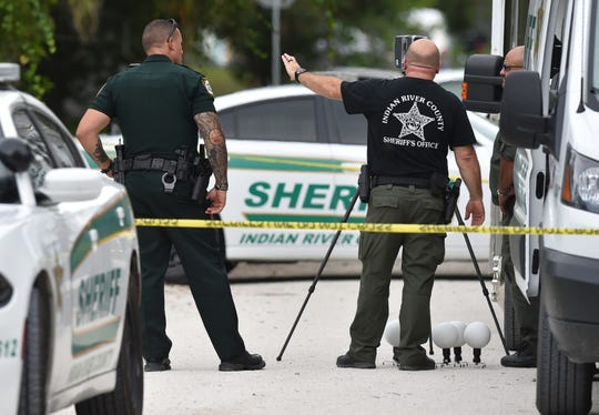 Indian River County Sheriff's Office deputies investigate the scene of a double shooting on Sunday, July 21, 2019, in Indian River County. A man and a woman were shot at a home in the 1300 block of 20th Court SW, and a suspect has been arrested.