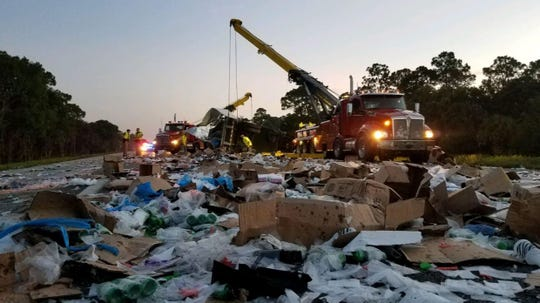 Crews early Sunday, July 21, 2019, clean up beauty supplies strewn on the southbound lanes of Interstate 95 between Fellsmere and Sebastian following a crash involving two tractor-trailer rigs and a pickup truck.