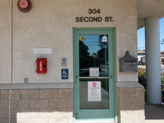 A doorbell with intercom and red emergency phone are visible at the entrance of Ventura County Fire Department Station 53 in Port Hueneme.