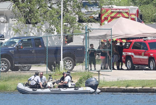 A rescue boat leaves the command post as the search continues for a missing swimmer in Lake Carmel July 21, 2019.