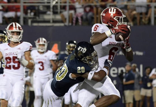 Indiana Hoosiers wide receiver Donavan Hale (6) is defended by FIU Golden Panthers defensive back Emmanuel Lubin (20) on a 2-yard touchdown reception in the second quarter at Riccardo Silva Stadium.