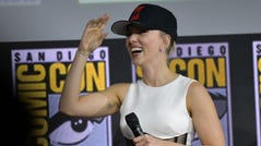 US actress Scarlett Johansson speaks on stage for the Marvel panel in Hall H of the Convention Center during Comic Con in San Diego, California on July 20, 2019. (Photo by Chris Delmas / AFP)CHRIS DELMAS/AFP/Getty Images ORIG FILE ID: AFP_1IZ0OB