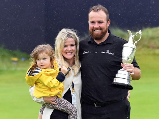 Shane Lowry stands with his wife Wendy and daughter Iris as he celebrates winning the British Open.
