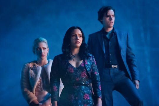 "Betty (Lili Reinhart, left)., Veronica (Camila Mendes) and Jughead (Cole Sprouse) are entering their senior year on ""Riverdale."""