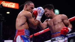 Manny Pacquiao lands a hit on Keith Thurman.