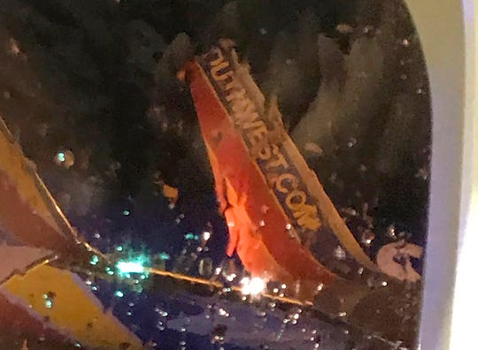 This photo taken onboard by a passenger on a Southwest Airlines flight to Atlanta appears to show the top fin of another Southwest plane clipped off after the two planes collided Saturday on the tarmac of Nashville International Airport.