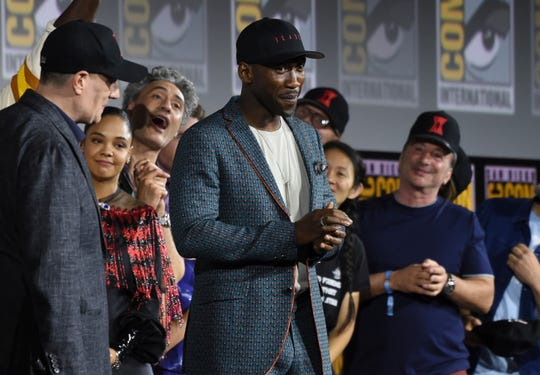 "Mahershala Ali (center) is introduced as the star of ""Blade"" at the Marvel Studios panel at Comic-Con."