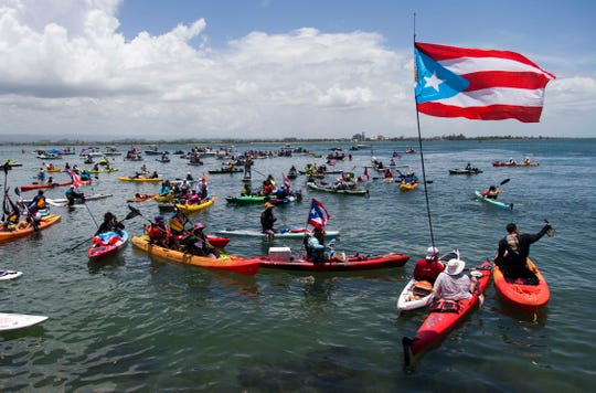 Demonstrators in kayaks gather in front of La Fortaleza for an aquatic protest against Puerto Rico Gov. Ricardo Rossello in San Juan, Puerto Rico, on July 21, 2019.