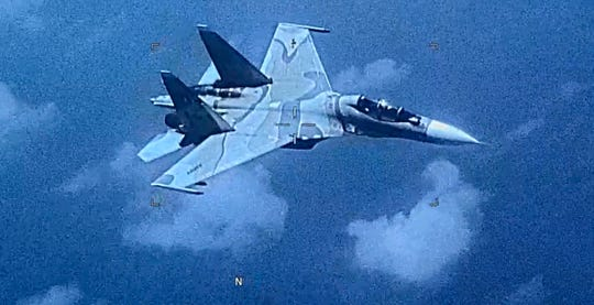 This image made from a  July 19, 2019, video provided by the U.S. Southern Command shows a Venezuelan SU-30 fighter jet over the Caribbean.