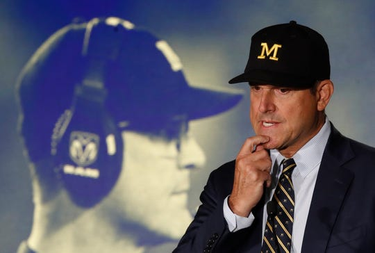 Michigan head coach Jim Harbaugh speaks during Big Ten Media Days.