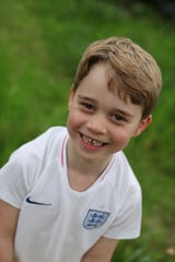 Prince George shows gaps in his teeth, adorably.