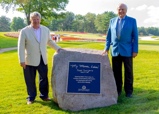 Sentry Insurance CEO Pete McPartland, left, and golf course architect Robert Trent Jones Jr. pose after a plaque was dedicated Friday at SentryWorld in Stevens Point.