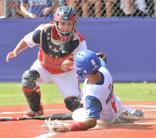 Midland Northern's Aiden Serrano, right, scores on Carlos LaMadrid's squeeze bunt as Abilene Dixie catcher Jace Crawford makes the tag in the fifth inning. Northern beat Dixie 8-1 to win the Little League Division title at the Texas West State Little League baseball tournament Monday at Kirby Park.