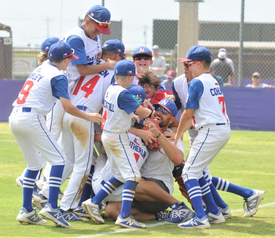 Midland Northern players celebrate an 8-1 victory over Abilene Dixie to win the Little League Division title at the Texas West State Little League baseball tournament Monday at Kirby Park.