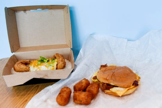 "Rise's ""Which Came First?"" gravy box and a bacon, egg and cheese sandwich with cheddar tots July 17, 2019."