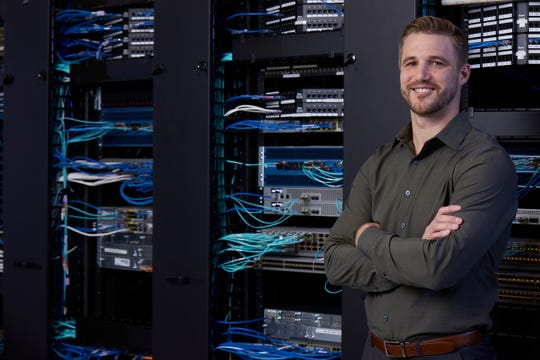 Kacy Reed is a solutions architect for Dewpoint, an IT company headquartered in Lansing with offices in metro Detroit, Grand Rapids and San Francisco. His job is considered part of the Professional Trades field, which has a strong need for Michigan workers now and in the coming years.
