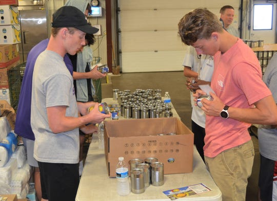 Members of the Lakeview football woke up early this weekend to spend a part of their summer together, but it wasn't to run sprints this time. The Spartans came out to volunteer at the Food Bank of South Central Michigan.