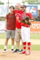 Former Binghamton and New York Mets pitcher Bill Pulsipher poses with his sons, Center Moriches player Liam Pulsipher (right) and Leyton, on the pitcher's mound after Center Moriches beat Seton Catholic Central, 10-7, in the Class B state final June 9, 2018 at NYSEG Stadium in Binghamton.