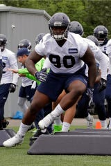 FILE - In this May 24, 2018, file photo, from left, Seattle Seahawks defensive tackle Jarran Reed (90) takes part in an agility drill during NFL football practice in Renton, Wash. Jarran Reed has been suspended for six games by the NFL for violating the personal conduct policy. The suspension stems from an incident in April 2017.