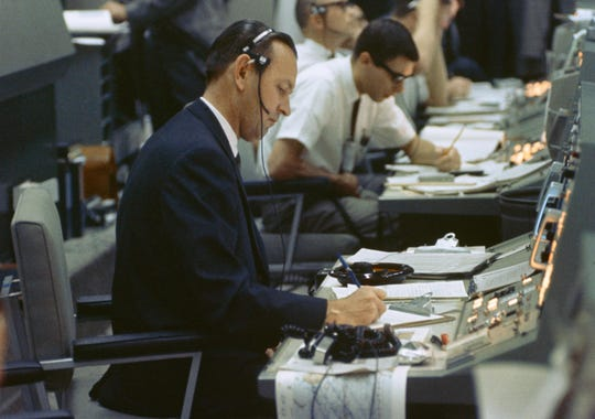 Christopher Kraft, an early architect of the U.S. space program, is seen at his console during Gemini-4 in 1965.