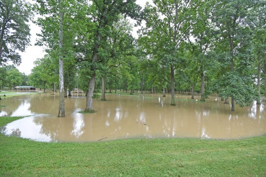 High waters kept a good portion of Aumiller Park under water Monday morning after heavy rain that started Sunday evening.