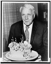 Robert Frost poses with a cake on his 85th birthday in this 1959 portrait by Walter Albertin.