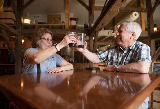 Phyllis Sharp and Joe Grant of Langhorne, PA, toast each  other as they celebrate their 20th anniversary at Cold Spring Brewery located in Lower Township, NJ.
