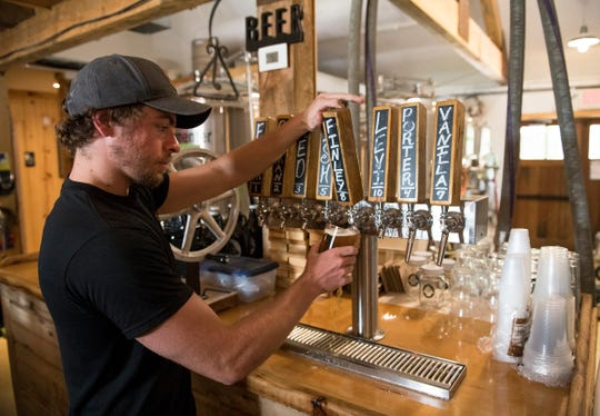Head brewer Dominic Jacob pours a Finley Forge IPA at Cold Spring Brewery located in Lower Township, NJ.